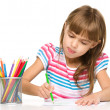 Little girl is drawing using pencils — Foto de Stock