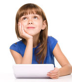 Young girl is using tablet — Fotografia Stock