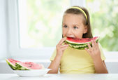 Cute little girl is eating watermelon — Stock Photo