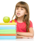 Little girl with her books — Stockfoto