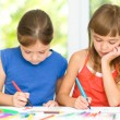Little girls are drawing using pencils — Stock Photo