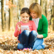 Mother and her daughter is playing with tablet — Stock Photo #37204641