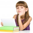 Young girl is using tablet — Stok fotoğraf