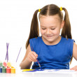 Little girl is painting with gouache — Stock Photo #37955473