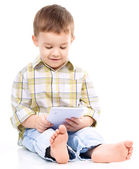 Young boy is using tablet — Stockfoto