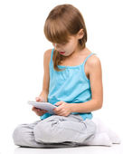 Young girl is using tablet — Stockfoto