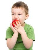 Portrait of a cute little boy with red apple — Stock Photo