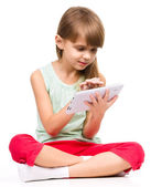 Young girl is using tablet — ストック写真