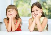 Portrait of two sad little girls — Stockfoto