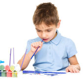 Boy is playing with paints — Stock Photo