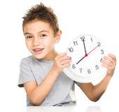 Boy is holding big clock — Stock Photo