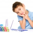 Young is daydreaming while drawing with paints — Stock Photo