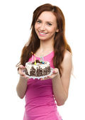 Young woman with anniversary cake — Stock Photo