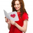 Young woman is reading Valentine card — Stock Photo #40456527
