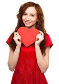 Young woman holding red heart — Stock Photo