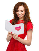 Young woman is reading Valentine card — Stock Photo