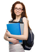 Young student girl is holding book — Stock Photo