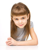 Little girl is looking out from the blank banner — Stock Photo