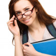 Stock Photo: Young student girl is holding book