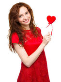 Young woman holding small red heart — Stock Photo