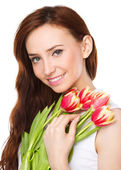 Young woman is holding bouquet of tulips — Stock Photo