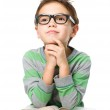 Young boy is daydreaming while reading book — Stock Photo #43141921