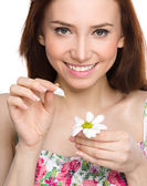 Young woman is tearing up daisy petals — 图库照片