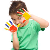 Portrait of a cute boy playing with paints — Foto Stock