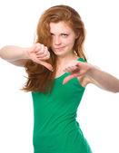 Woman is showing thumb down gesture — Zdjęcie stockowe