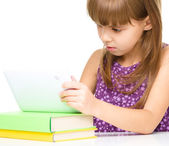 Young girl is using tablet — Photo
