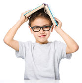 Little boy plays with book — Foto Stock