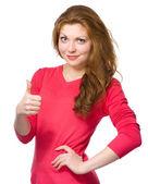 Kobieta pokazuje kciuk gest — Zdjęcie stockowe