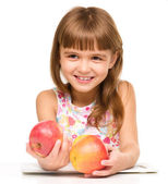 Little girl with red apples — Foto Stock