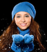 Young happy woman under snowfall — Stock Photo