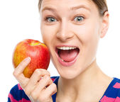 Young happy girl with apple — Stock Photo