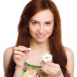 Young woman is tearing up daisy petals — Stock Photo #46048035