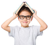 Little boy plays with book — Stock Photo