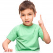 Little boy is pointing up using his index finger — Stock Photo #46058009