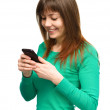 Young woman is typing sms message on her phone — Stock Photo #47087423