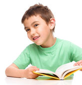 Little boy plays with book — Foto de Stock