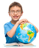 Little boy is examining globe — Stock Photo