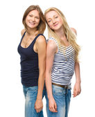Two young happy women posing — Stock Photo