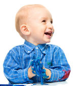 Little boy is playing with paints — Stock Photo