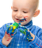 Little boy is playing with paints — Stock fotografie