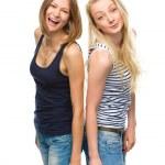 Two young happy women posing — Stock Photo #48721573