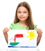 Little girl is showing her painting — Stock Photo