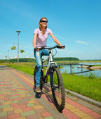 Young woman is riding on her bicycle — Foto Stock