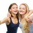 Two young happy women showing thumb up sign — Stock Photo