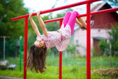 Cute little girl is playing in playground — Stock Photo