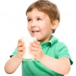 Cute little boy with a glass of milk — Stock Photo #50358091